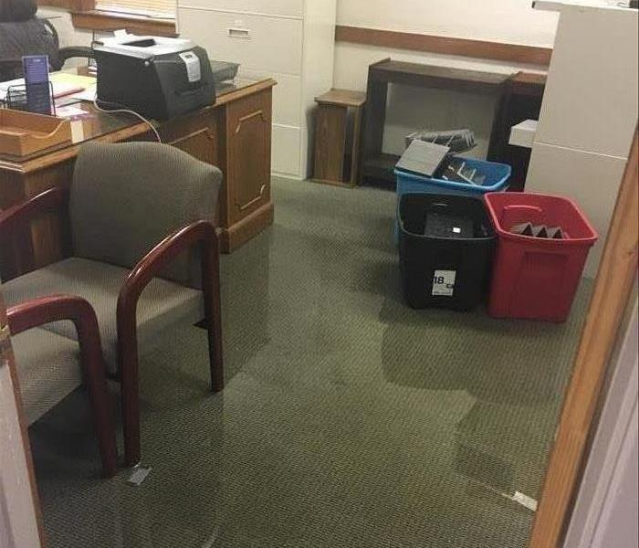 room with carpet that has standing water and chairs and tubs and office supplies
